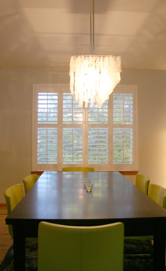 Plantation shutters and new modern Capiz shell chandelier