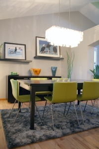 Pale modern grey walls, lime green leather chairs, new chandelier - definitely an upgrade!