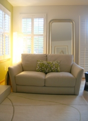 A much smaller love seat and two small side chairs don't overwhelm the space any longer.