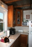 Before: Dated cabinetry and not enough storage