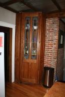 Before: Corner curio cabinet