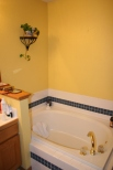 Yellow walls, brass facets, white and blue tile, and yellow walls. It was time for a remodel!