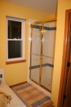 Small shower with brass and glass door