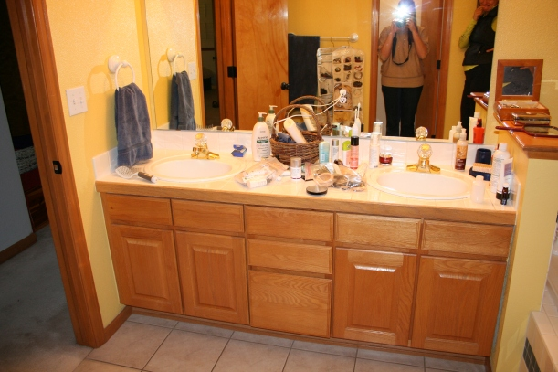 Outdated master bath with oak vanity and tiled floor