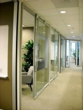 Glass wall system for the office fronts to keep an open feel in the space