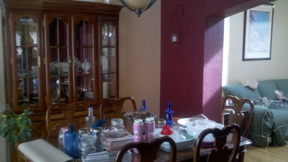 Before - Burgundy walls, dark furniture, and outdated chandelier